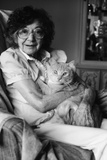 1980s Elderly Senior Woman Wearing Glasses Holding Tabby Cat in Her Arms