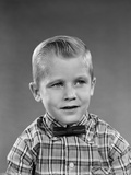 1950s-1960s Portrait Smiling Blond Boy Wearing Plaid Madras Shirt and Bow Tie