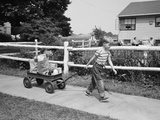 1950s Boy Pulling Groceries in Wagon