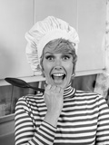1970s Woman Portrait Wearing Chef's Toque in Kitchen with Surprised Face