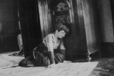 Young Girl Listens to the Radio While Reading Paper  Ca 1930