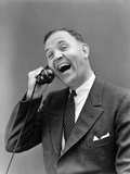 1930s Man in Suit Laughing Talking on Telephone