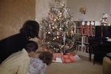 Children Peeking around Corner at Christmas Tree