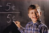 Boy Subtracting on a Blackboard
