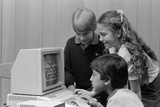 1980s Boys and Girl Playing Games on a Computer