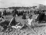 1920s Two Women Sitting on the Beach in Bathing Suits
