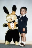 Little Boy Stands with His Large Easter Bunny  Ca 1954