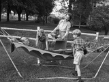 1950s Mom and Kids Serving Dad in Hammock