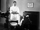 1930s-1940s Dentist Speaking with a Female Patient