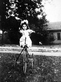 Large Play Doll Sits on a Period Tricycle  Ca 1925