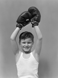 1940s Boy Child Winner Wearing Boxing Gloves Holding Hands Above Head