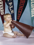 1960s Baby Shouting into Cheerleader Megaphone College Pennants in Background