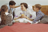 Children Serving Mother Breakfast in Bed