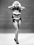1950s Young Woman Standing Inside Wearing Fur Trimmed Bikini and Gloves