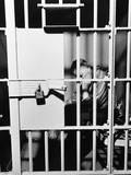 1960s Man Seated on Bench in Jail Cell with Head in Hand Looking Downward