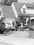 1940s-1950s Family in Front of Suburban House