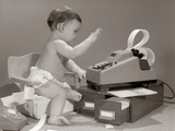 1960s Baby Seated in Small Chair Hitting Keys on Office Adding Machine on Top of Small File Drawers