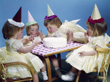 1950s-1960s Quadruplets 4 Red Haired Girls Wearing Party Hats and Dresses Sitting at Table
