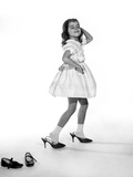 1960s Girl Making Glamour Pose Having Stepped Out of Her Shoes into Her Mothers Adult High Heels
