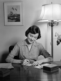 1940s-1950s Woman Sitting at Desk Writing Letters Doing Correspondence