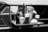 Food Tray with Soda Fountain Items on Car Window at 1950s Style Drive-In Restaurant