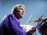 1970s Musician Blond Man Playing Drums Wearing Purple Shirt
