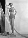 1950s Glamour Girl Posed in Studio Draped in Fishing Net Wearing Two Piece Bathing Suit