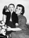 Little Boy Holding Football with His Mother  Ca 1955