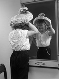 1950s Little Girl Trying on Hat Looking into Mirror Reflection