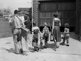 1950s Family Mother Father 3 Children from Behind Carrying Gardening Home Improvement Tools