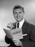 1950s-1960s Man in Business Suit Holding Pencil and Budget Book