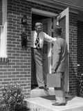1950s Salesman Talking to Man at Front Door
