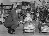 1950s Father in Toy Store Purchasing for Son Driving Toy Convertible Peddle Car