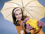 1960s Smiling Brunette Woman Holding Bouquet Autumn Flowers Chrysanthemums under Umbrella