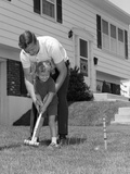 1960s Father and Young Daughter Playing Croquet in Yard