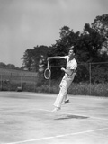 1930s Man Playing Tennis Jumping Mid Air Action