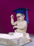 1960s Graduate Baby Wearing Mortarboard Eyeglasses Reading Book