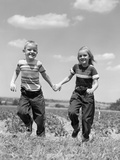 1950s Boy Girl Running Grassy Farm Field Holding Hands