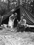 1920s Camping Couple Man Sitting by Tent with Fishing Rod Woman Standing Wearing Bathing Suit