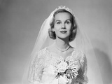1950s Portrait of Bride Wearing White Wedding Dress Holding a Bouquet of Flowers