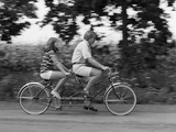 1970s Teenage Girl and Boy Riding Bicycle Built for Two