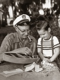 1950s-1960s Young Boy with Smiling Grandfather Building Model Boat