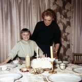 Nine Year Old Girl Is About to Blow Out the Candles on Her While Her Mom Watches  Ca 1962