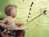 1960s Baby in High Chair Using Wooden Pointer to Indicate Low Pressure Area on Weather Map
