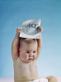 1960s Baby Holding Budget Sign Above His Head