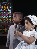 1960s African American Boy and Girl Brother and Sister Standing by Stained Glass Window in Church