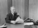 1930s Senior Executive Speaking into a Dictaphone
