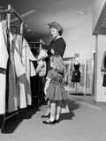 1960s Mother and Daughter Shopping for Clothes in Aisle of Department Store