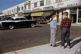 Boys Standing Alongside Strip Mall Parking Lot
