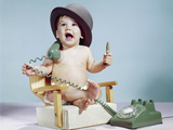 1960s Baby Boy Sitting Booster Chair Holding Cigar Wearing Hat Holding Telephone